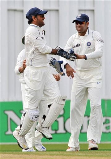 MS Dhoni celebrates with VVS Laxman the wicket of Daniel Flynn on Day 1 of the first Test at Seddon Park in Hamilton. (AP Photo)
