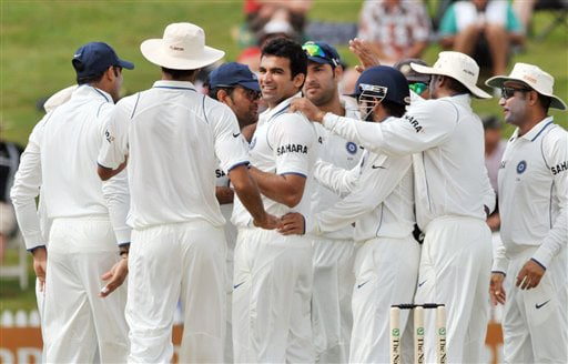 Indian team celebrates with Zaheer Khan after he took the wicket of Daniel Flynn for 0 on Day 1 of the first Test at Seddon Park in Hamilton. (AP Photo)