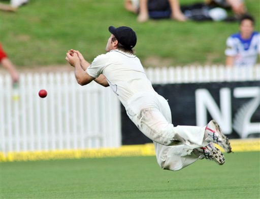 Daniel Flynn drops the catch which would have taken Sachin Tendulkar for 14 on the second day of the first Test in Hamilton, New Zealand. (AP Photo)
