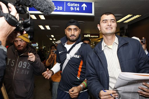 Harbhajan Singh, centre, arrives at Christchurch airport on Friday, February 20, 2009. India will play three Test matches, five one-day internationals and two twenty20 matches during the cricket tour of New Zealand. (AP Photo)