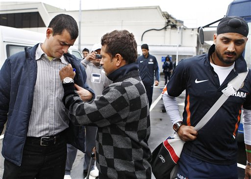 Sachin Tendulkar, centre, signs his autograph on his arrival at Christchurch airport on Friday, February 20, 2009. India will play three Test matches, five one-day internationals and two twenty20 matches during the cricket tour of New Zealand. (AP Photo)