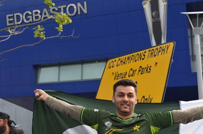 A Pakistan fan gives full vent to his feelings before the game gets underway.