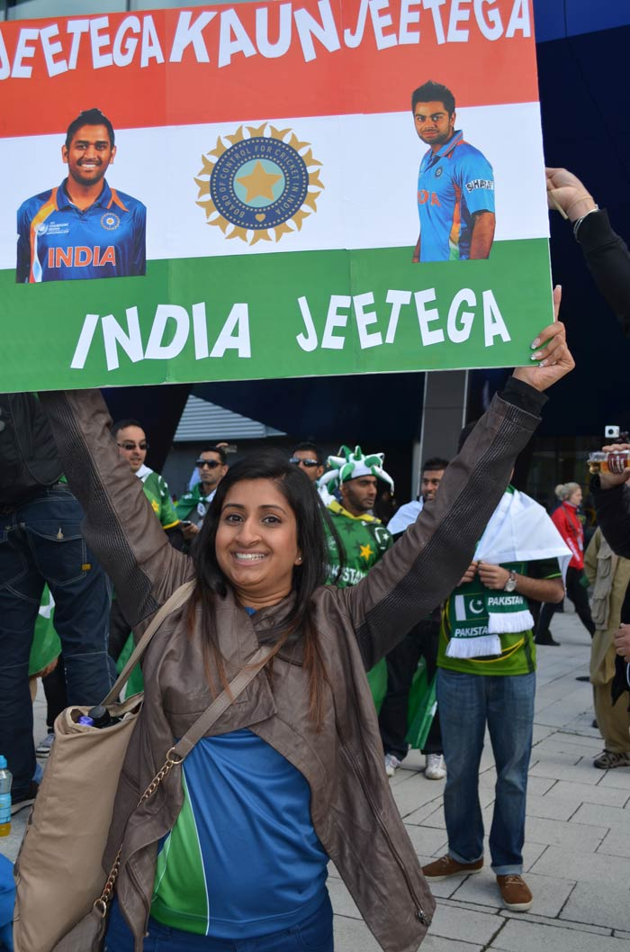 The placard says it all, full-on support for India is this fan's mantra.