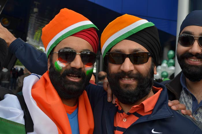 These two fans lend a touch of colour to their patriotism and they are not averse to expressing it.