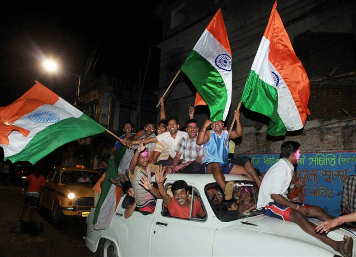 Indian fans celebrate the team's victory over Pakistan in the Cricket World Cup semifinal match, in Kolkata. (PTI Photo)