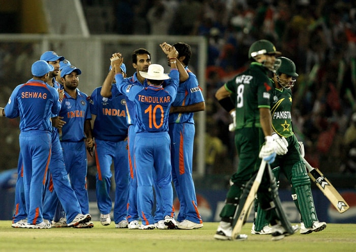 Indian players celebrate the wicket of Kamran Akmal of Pakistan caught by Yuvraj Singh from the bowling of Zaheer Khan. (AFP Photo)