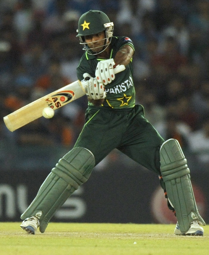 Pakistan batsman Asad Shafiq batted well fr his 30 off 39 balls but was dismissed in emphatic fashion by Yuvraj Singh. (AFP Photo)
