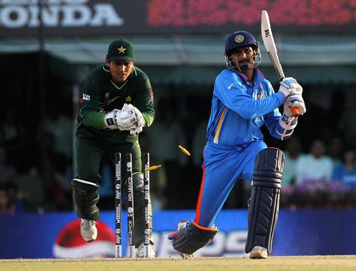Harbhajan Singh of India is stumped by Kamran Akmal. (Getty Images)
