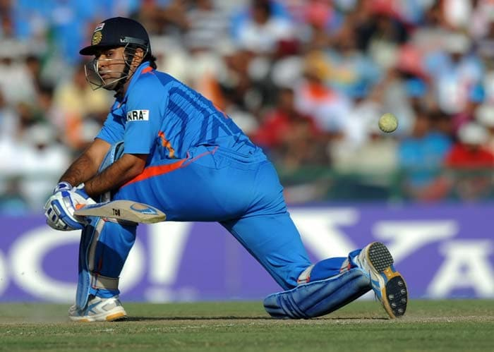 Indian skipper Mahendra Singh Dhoni plays a shot during the semi final match. (Getty Images)