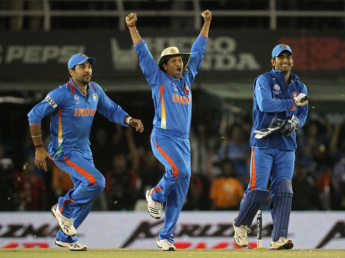 Yuvraj Singh, Sachin Tendulkar and MS Dhoni celebrate victory during the 2011 ICC World Cup second semi final. (AFP Photo)