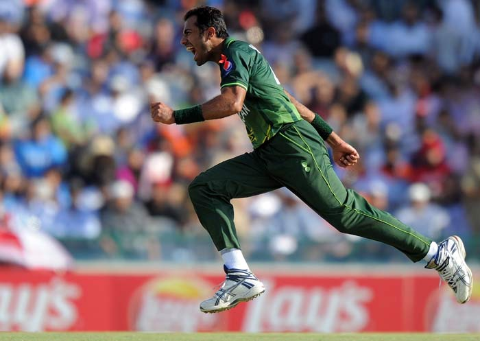 Pakistani fast bowler Wahab Riaz celebrates after taking the wicket of Indian cricketer Yuvraj Singh. (AFP Photo)