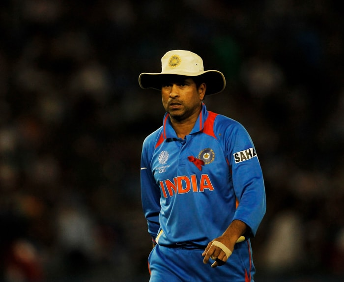 Sachin Tendulkar of India walks back to field as India began their attempt to defend the total of 260. (Getty Images)