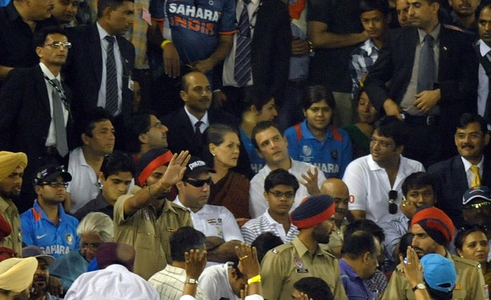 India Congress Party leader Sonia Gandhi and her son Rahul Gandhi sit in the stands. (AFP Photo)