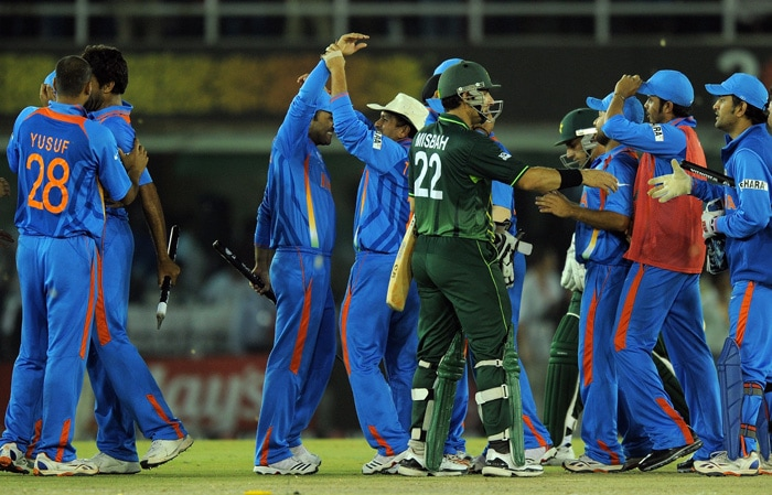 Indian cricket team players celebrate after beating Pakistan in the ICC Cricket World Cup 2011 semifinal. (AFP Photo)