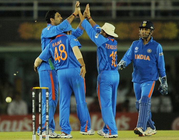 Indian cricketer Yuvraj Singh celebrate with teammates after taking the wicket of Pakistan batsman Asad Shafiq. (AFP Photo)