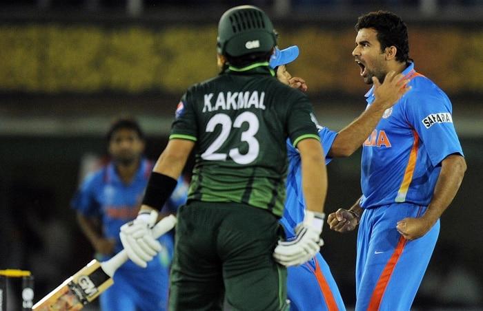 Indian fast bowler Zaheer Khan reacts after taking the wicket of Pakistan opener Kamran Akmal. (AFP Photo)