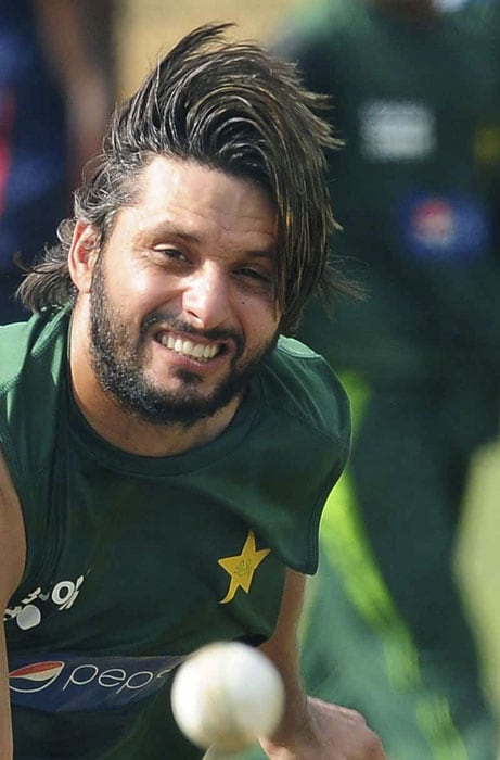 Pakistan captain Shahid Afridi throws a ball during a practice session. (AFP PHOTO)