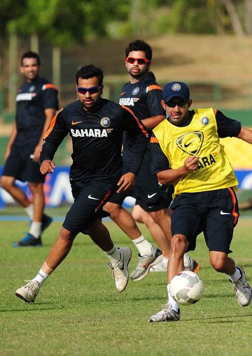 Indian cricketers Gautam Gambhir,Rohit Sharma and Virat Kohli play football during a training session. (AFP PHOTO)