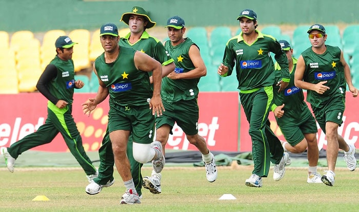 Pakistan cricketers warm up during a training session. (AFP PHOTO)