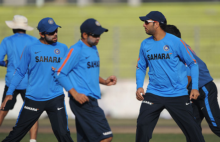 Yuvraj Singh stretches with his teammates during a practice session at the Sher-e Bangla National Stadium in Dhaka. (AFP Photo)