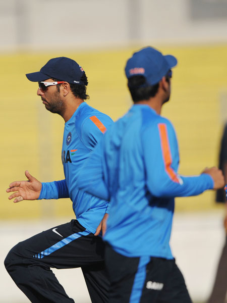 Yuvraj Singh jogs with his teammates during a practice session at the Sher-e Bangla National Stadium in Dhaka. (AFP Photo)