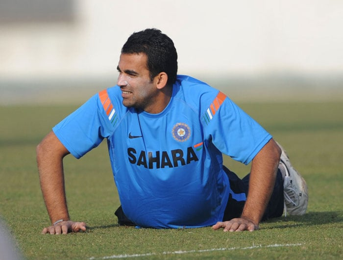Zaheer Khan stretches with his teammates during a practice session at the Sher-e Bangla National Stadium in Dhaka. (AFP Photo)