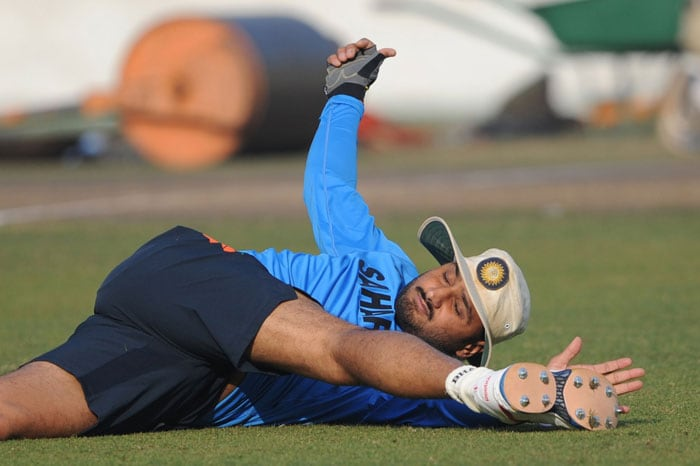 Harbhajan Singh stretches during a practice session at the Sher-e Bangla National Stadium in Dhaka. (AFP Photo)