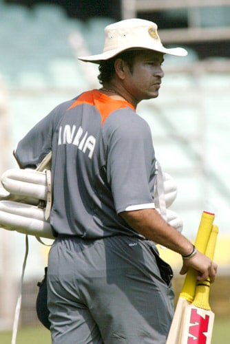 Sachin Tendulkar walks with his gear for a net practice session in Chennai on Tuesday, March 25, 2008. The first Test of Future Cup cricket series between India and South Africa is scheduled to start on March 26.