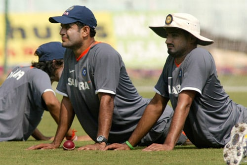 Harbhajan Singh, right, and Irfan Pathan stretch during a practice session in Chennai on Tuesday, March 25, 2008. The first Test of the Future Cup series between India and South Africa is scheduled to start on March 26.