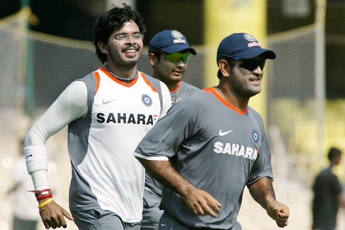 Shantakumaran Sreesanth, left, Piyush Chawla, center, and Mahendra Singh Dhoni run during a practice session in Chennai on Tuesday, March 25, 2008. The first Test of Future Cup cricket series between India and South Africa is scheduled to start on March 26.