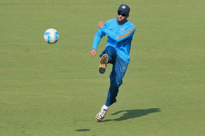Indian captain Mahendra Singh Dhoni plays football during a training session ahead of the final Test match against Sri Lanka in Mumbai on December 1, 2009. Test cricket returns to Mumbai's venerable 72-year old Brabourne stadium after 36 years when India and Sri Lanka clash in the third and final match, during the renovation of the Wankhede Stadium which was built by the Mumbai Cricket Association in 1974. India lead the 3-match series 1-0. (AFP Photo)