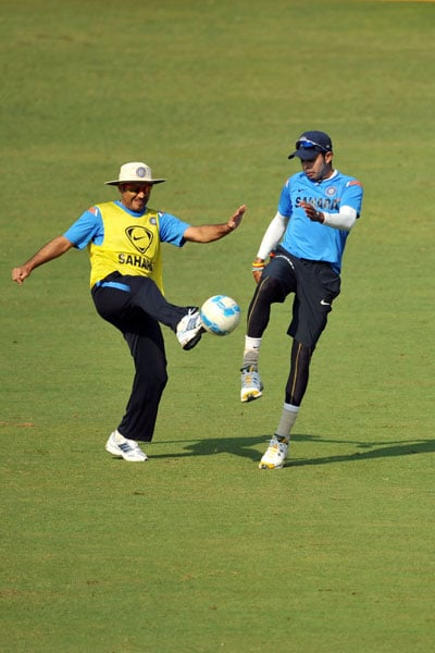 Virender Sehwag and Sreeshanth play football during a training session ahead of the final Test against Sri Lanka in Mumbai. (AFP Photo)