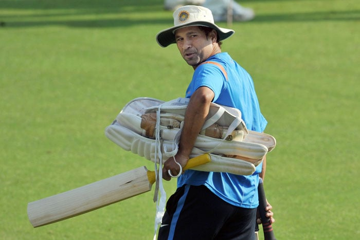 Sachin Tendulkar walks to bat during a training session ahead of the final Test against Sri Lanka in Mumbai. (AFP Photo)