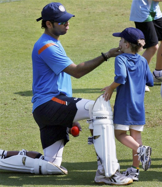 Yuvraj Singh with Gary Kirsten's son, Joshua during a practice session ahead of the third Test match between India and Sri Lanka in Mumbai. (PTI Photo)