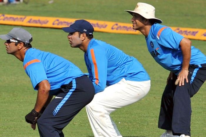 Rahul Dravid, VVS Laxman and Sachin Tendulkar watch the ball during a training session ahead of the third and final Test match against Sri Lanka in Mumbai. (AFP Photo)
