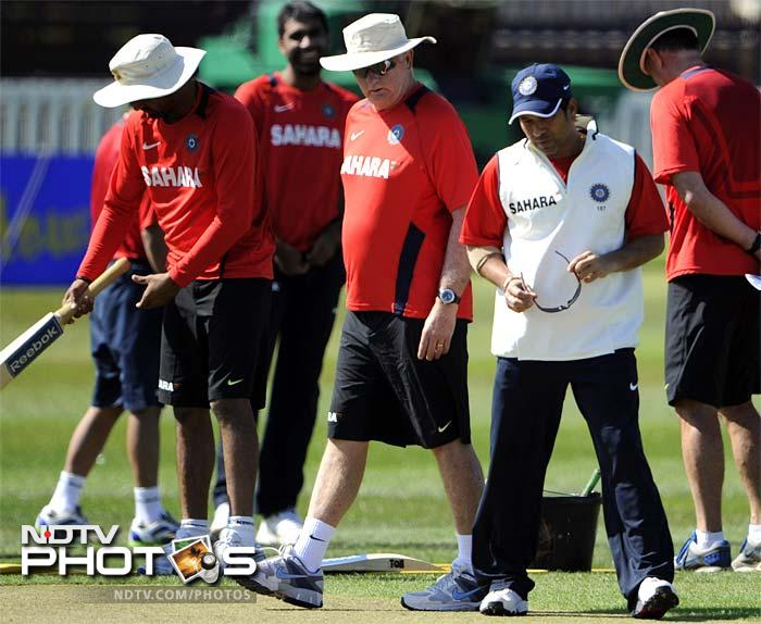 Indian cricket coach Duncan Fletcher, 3rd right, and Sachin Tendulkar, 2nd right, look at the pitch during the practice session in Taunton, England. (AP Photo)