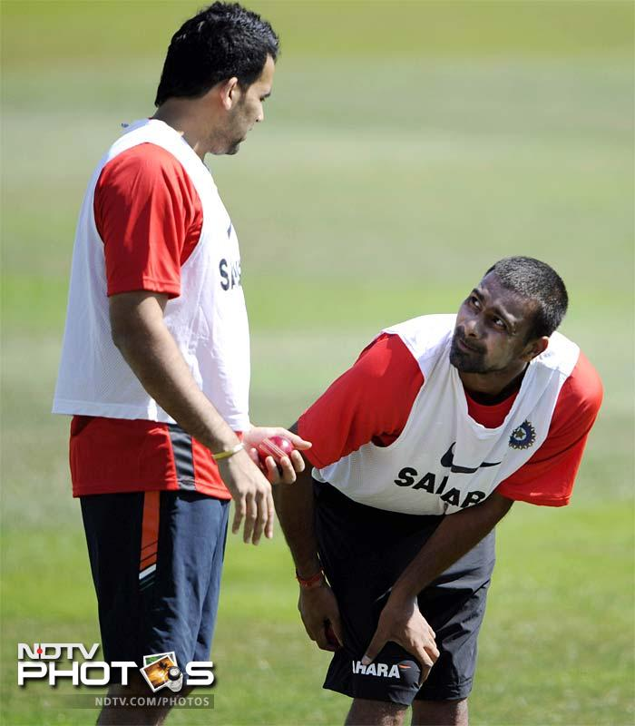 India's Zaheer Khan (L) seems to be sharing a few words of wisdom with fellow-pacer Praveen Kumar during the net practice in Taunton, England. (AP Photo)