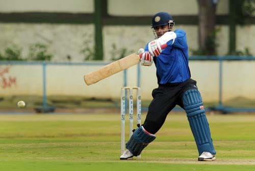 S. Badrinath bats during a practice match at the National Cricket Academy (NCA) in Bangalore. (AFP Photo)