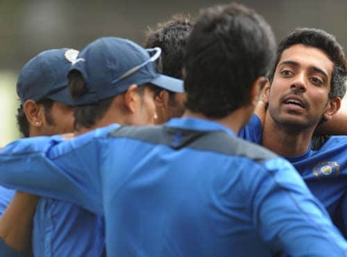 Dhabal Kulkarni interacts with teammates during a practice match at the National Cricket Academy (NCA) in Bangalore. (AFP Photo)