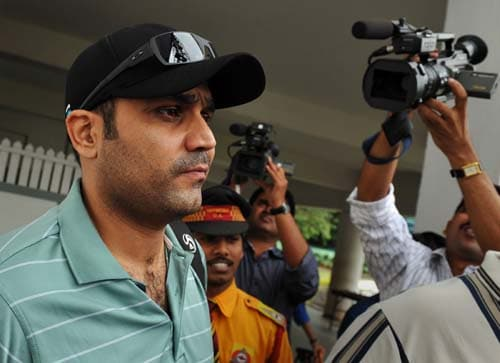 Virender Sehwag leaves the National Cricket Academy (NCA) in Bangalore. (AFP Photo)