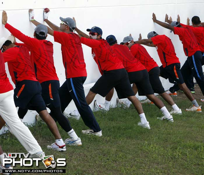 Indian players stretch at the beginning of a practice session in Kingston, Jamaica. (AP Photo)