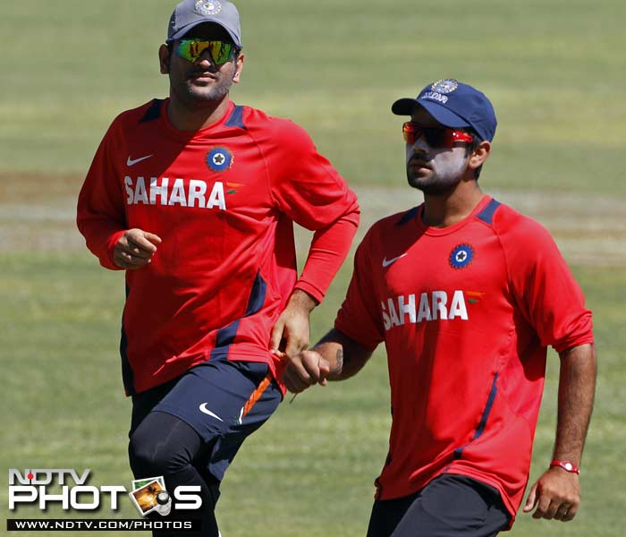 Indian captain Mahendra Singh Dhoni (L) and Virat Kohli warm up during a practice session in Kingston, Jamaica. (AP Photo)
