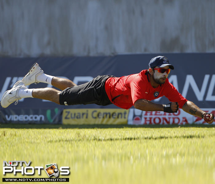 India's Virat Kohli takes a diving catch during a practice session in Kingston, Jamaica. (AP Photo)