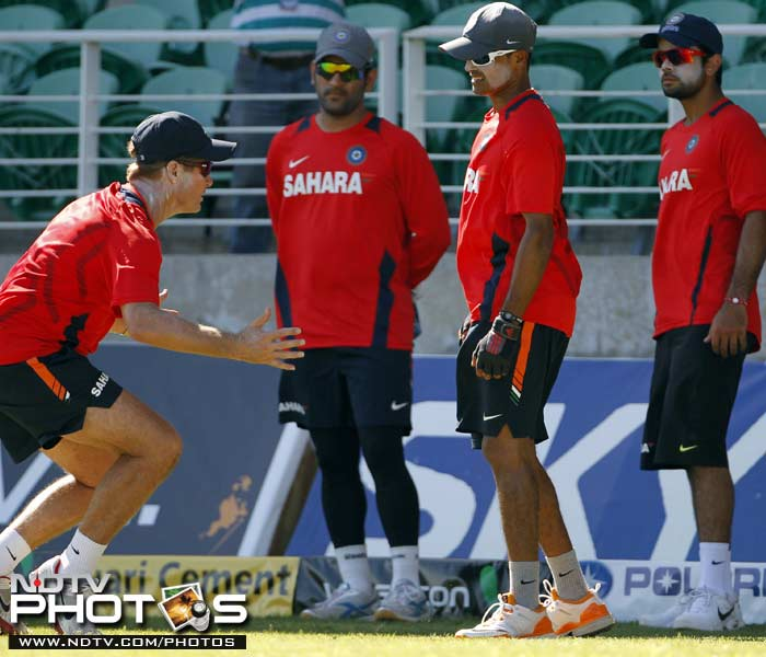 India's fielding coach Trevor Penney (L) shows a technique to players - Subramaniam Badrinath, Virat Kohli (R) and captain Mahendra Singh Dhoni (L) during a practice session in Kingston, Jamaica. (AP Photo)