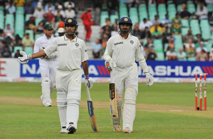 MS Dhoni walks off the pitch with teammate Harbhajan Singh after umpires stopped play due to poor light on the first day of the second Test between India and South Africa at the Kingsmead Stadium in Durban. (AFP Photo)