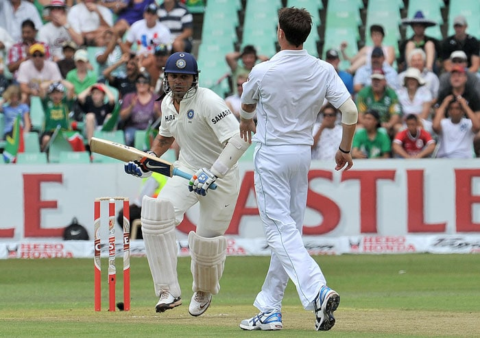 Murali Vijay makes a run past Dale Steyn on the first day of the second Test at Kingsmead Stadium in Durban. (AFP Photo)