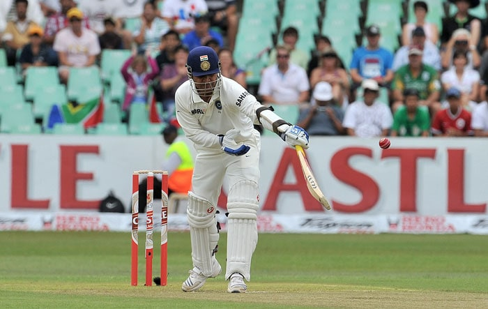 Virender Sehwag reacts to a shot from Dale Steyn during on the first day of the second Test at Kingsmead Stadium in Durban. (AFP Photo)