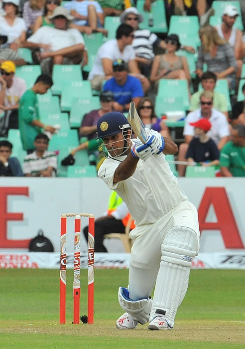 Mahendra Singh Dhoni plays a shot on the first day of the second Test between India and South Africa at the Kingsmead Stadium in Durban. (AFP Photo)