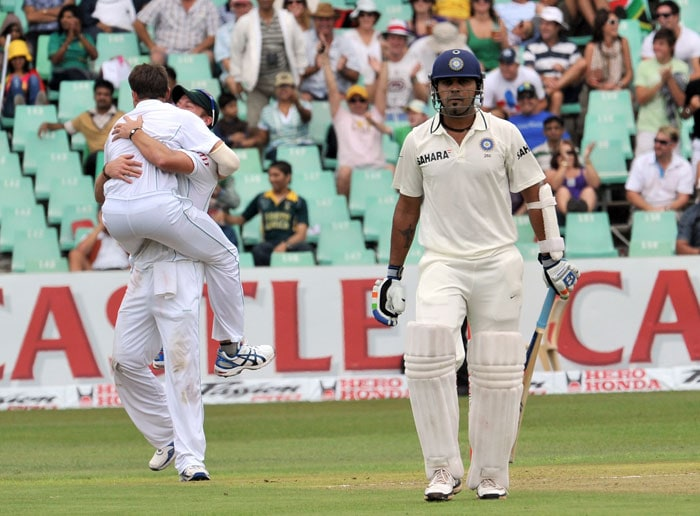 Dale Steyn celebrates with teammate after dismissing Murali Vijay on the first day of the second Test at Kingsmead Stadium in Durban. (AFP Photo)