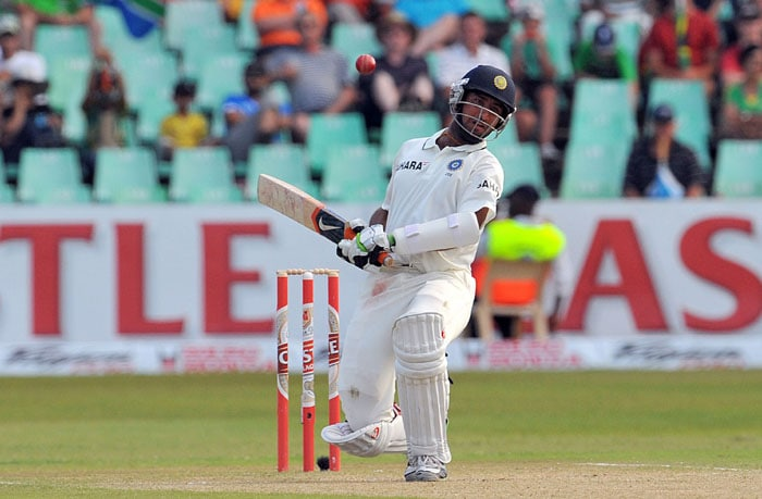 Indian Cheteshwar Pujara avoids a bouncer on the second day of the second Test between South Africa and India at Kingsmead Stadium in Durban. (AFP Photo)